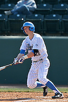 Trevor Brown #11 of the UCLA Bruins bats against the Maryland Terrapins at Jackie Robinson Stadium on February 19, 2012 in Los Angeles,California. Maryland defeated UCLA 5-1.(Larry Goren/Four Seam Images)