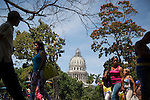 HAVANA, CUBA -- MARCH 23, 2015:  People walk past the National Capitol Building in Havana, Cuba on March 23, 2015. Photograph by Michael Nagle