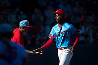 Spokane Indians designated hitter Sherten Apostel (38) is congratulated by a teammate after scoring a run during a Northwest League game against the Vancouver Canadians at Avista Stadium on September 2, 2018 in Spokane, Washington. The Spokane Indians defeated the Vancouver Canadians by a score of 3-1. (Zachary Lucy/Four Seam Images)