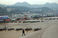 """Chaotianmen Port in Chongqing, it is located at the end of Three Gorges. Chongqing is China's largest city and is often termed a """"super-city"""". It is at the far shore of the 600 km long Three Gorges Dam and is the """"gateway to western China"""". Large sums of money are being pumped into the  area and infrastructural projects and building development is ongoing..16-NOV-04"""