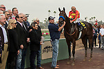 ARCADIA, CA  JANUARY 06: #6 McKinzie, ridden by Mike Smith,in the winners circle after  winning the Sham Stakes (Grade lll) on January 6, 2018, at Santa Anita Park in Arcadia, CA. (Photo by Casey Phillips/ Eclipse Sportswire/ Getty Images)
