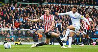 Leeds United's Tyler Roberts shoots at goal under pressure from /Brentford's Chris Mepham<br /> <br /> Photographer Alex Dodd/CameraSport<br /> <br /> The EFL Sky Bet Championship - Leeds United v Brentford - Saturday 6th October 2018 - Elland Road - Leeds<br /> <br /> World Copyright &copy; 2018 CameraSport. All rights reserved. 43 Linden Ave. Countesthorpe. Leicester. England. LE8 5PG - Tel: +44 (0) 116 277 4147 - admin@camerasport.com - www.camerasport.com