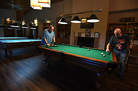 NWA Democrat-Gazette/J.T. WAMPLER Larry Curry(LEFT) racks the balls before playing pool with John Blankenship, both of Fayetteville, Monday August 5, 2019 in the pool room at the Fayetteville Senior Activity & Wellness Center. For more information about activities at the center visit www.fayetteville-ar.gov/305/Senior-Activity-Wellness-Center