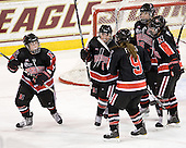 Casey Pickett (NU - 14), Dani Rylan (NU - 2), Casie Fields (NU - 9), Julia Marty (NU - 16) and Katie MacSorley (NU - 3) celebrate Rylan's game tying goal. - The Northeastern University Huskies tied Boston University Terriers 3-3 in the 2011 Beanpot consolation game on Tuesday, February 15, 2011, at Conte Forum in Chestnut Hill, Massachusetts.