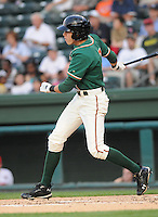 Outfielder Christian Yelich (7) of the Greensboro Grasshoppers in a game against the Greenville Drive on April 26, 2011, at Fluor Field at the West End in Greenville, South Carolina. Yelich was a first-round pick by the Florida Marlins in the 2010 First-Year Player Draft. (Tom Priddy/Four Seam Images)