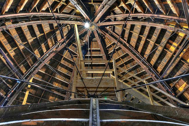 Apr. 26, 2015; Jason Railton, Manager of AV Technologies & Facilities Design, climbs a ladder inside the dome. (Photo by Barbara Johnston/University of Notre Dame)