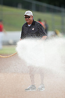Kannapolis Intimidators head grounds keeper Billy Ball waters the infield prior to the game against the Greensboro Grasshoppers at CMC-Northeast Stadium on June 9, 2015 in Kannapolis, North Carolina.  The Intimidators defeated the Grasshoppers 6-4.  (Brian Westerholt/Four Seam Images)
