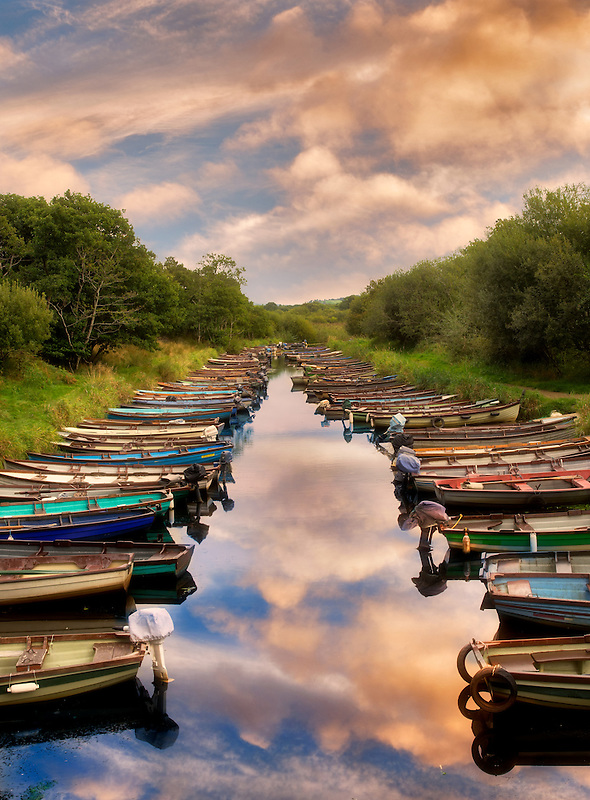 Fishing boats in small inlet. Killarney National Park, Ireland.