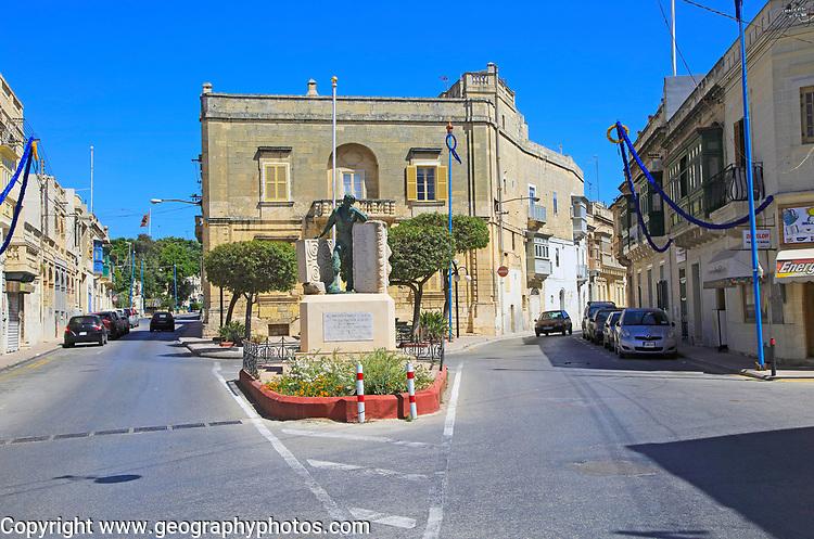 Historic streets in Tarxien area, near Valletta, Malta small square with war memorial sculpture
