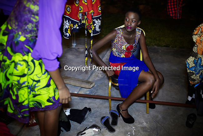 DAR ES SALAAM, TANZANIA - DECEMBER 6: Models relax backstage before fashion shows at Swahili Fashion week on December 6, 2013 in Dar Es Salaam, Tanzania. The yearly fashion week show local Swahili designers work and invited African designers. (Photo by: Per-Anders Pettersson)