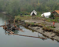 Fish camp utilizing a fish wheel (at left).