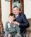 Jack O' Hanlon Daughton pictured with his father Mike after receiving his First Holy Communion last Saturday in Irremore Church , Lixnaw.