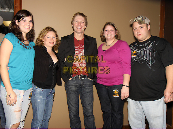 CRAIG MORGAN & fans .backstage before his concert at Cowboys Country Club, Kennesaw, GA, USA, November 20th 2009..half length red t-shirt black suit jacket jeans .CAP/ADM/DH.©Dan Harr/AdMedia/Capital Pictures.