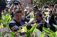 Unite the Right rally organizer Jason Kessler is pushed by a protestor who disrupted his press conference Sun., August 13, 2017 outside City Hall in Charlottesville, Va. The previous day, a woman was killed and several others injured after the Unite the Right rally, organized by Jason Kessler. Photo/Andrew Shurtleff