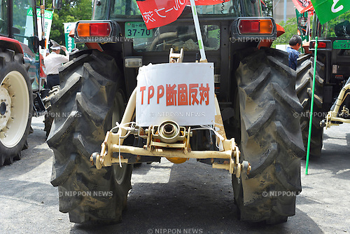 May 25th, 2013 : Tokyo, Japan - Agrimotors were brought to a demonstration against Trans-Pacific Strategic Economic Partnership Agreement, or TPP, at Shiba Park, Minato, Tokyo, Japan on May 25, 2013. According to a demonstration authority, there were more than 2,000 people showed up from all over the nation. (Photo by Koichiro Suzuki/AFLO)