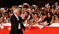"L'attore statunitense Richard Gere saluta i fans dal red carpet per la presentazione del film ""Time Out of Mind"" al Festival Internazionale del Film di Roma, 19 ottobre 2014.<br /> U.S. actor Richard Gere greets fans as he walks on the red carpet to present the movie ""Time Out of Mind"" during the international Rome Film Festival at Rome's Auditorium, 19 October.<br /> UPDATE IMAGES PRESS/Riccardo De Luca"