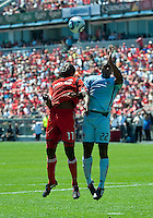 10 July 2010: Colorado Rapids defender Marvell Wynne #22 and Toronto FC forward O'Brian White #17 in action during a game between the Colorado Rapids and Toronto FC at BMO Field in Toronto..Toronto FC won 1-0.