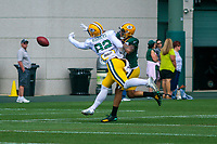 Green Bay Packers tight end Richard Rodgers (82) and safety Josh Jones (27) battle for a ball during a training camp practice on August 29, 2017 at Ray Nitschke Field in Green Bay, Wisconsin.   (Brad Krause/Krause Sports Photography)