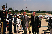 United States Secretary of Defense William S. Cohen (right) escorts Steven Spielberg (left) through a military honor cordon into the Pentagon in Washington, D.C. on August 11, 1999.   Cohen will later present the Department of Defense Medal for Distinguished Public Service to Spielberg.                                              .Mandatory Credit: Helene Stikkel / DoD via CNP..