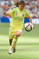June 12, 2015: Nahomi KAWASUMI of Japan runs with the ball during a Group C match at the FIFA Women's World Cup Canada 2015 between Cameroon and Japan at BC Place Stadium on 12 June 2015 in Vancouver, Canada. Japan won 2-1. Sydney Low/AsteriskImages