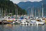 Jetty and boat marina overlooked by homes in Deep Cove, Burrard Inlet,Vancouver, British Columbia, Canada.
