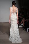 Model walks runway in Ashley - a slim softly fluted French lace gown with lace straps and plunging back neckline, from the Anna Maier Couture Collection 45 by Charles W. Bunstine II, at 32 West 39 Street on April 17, 2016 during New York Fashion Week Spring Summer 2017.