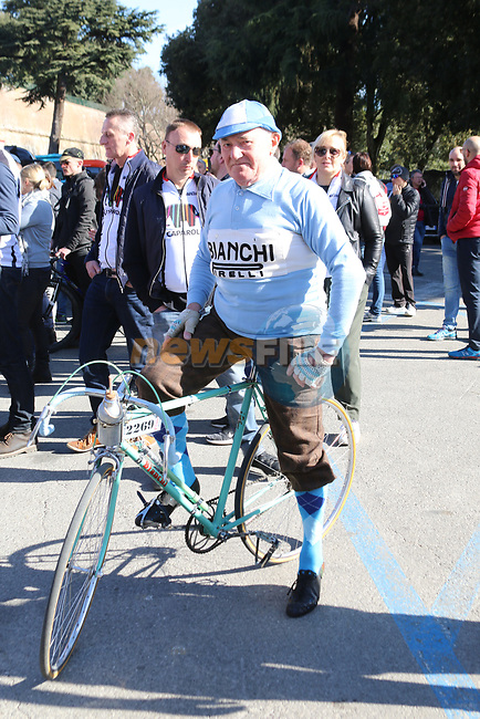 Old timer on his vintage Bianchi before the start of Strade Bianche 2019 running 184km from Siena to Siena, held over the white gravel roads of Tuscany, Italy. 9th March 2019.<br /> Picture: Seamus Yore | Cyclefile<br /> <br /> <br /> All photos usage must carry mandatory copyright credit (© Cyclefile | Seamus Yore)