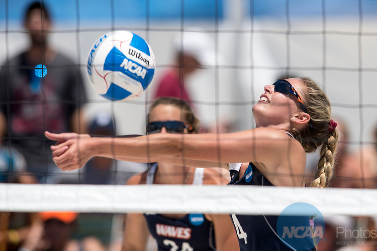 GULF SHORES, AL - MAY 07:  Nikki Lyons (4) of Pepperdine hits the ball during the Division I Women's Beach Volleyball Championship held at Gulf Place on May 7, 2017 in Gulf Shores, Alabama.The University of Southern California defeated Pepperdine 3-2 to claim the national championship. (Photo by Stephen Nowland/NCAA Photos via Getty Images)