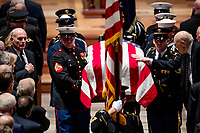 President Donald Trump's Chief of Staff John Kelly, left, watches as Former Sen. Alan Simpson, R-Wyo, right, touches the flag-draped casket of former President George H.W. Bush as it is carried out by a military honor guard during a State Funeral at the National Cathedral, Wednesday, Dec. 5, 2018, in Washington. <br /> CAP/MPI/RS<br /> &copy;RS/MPI/Capital Pictures