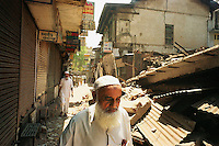Ahmadabad, India, March 2002.The communal riots between Hindus and Muslems have caused major damages in many areas of this 5.5 million inhabitants city. Thousands of homes, shops, cars, scooters, mainly belonging to the already poorer Muslem minority were torched, resulting in severe economic hardship for hundred of thousands of people.