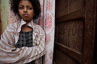 India, 17, sex worker from Jarso, waits for customers in front of her private room's door in Babile, Ethiopia on Monday August 14 2006..tens of young girls work in small bars in the boarder town of Babile, where the rat of HIV infections is among the highest in the country. they seel their bodies for less than 2 USD. None of these girls test for HIV and frequently are frequently forced into unprotected sex..Ethiopia is one of the countries most affected by HIV/AIDS. Of its population of 77 million, three million are HIV-positive, according to government statistics. Every day sees 1,000 new infections. A million children under 14 have lost one or both parents to AIDS, and 200,000 children are living with AIDS. That makes Ethiopia the country with the most HIV-positive children.