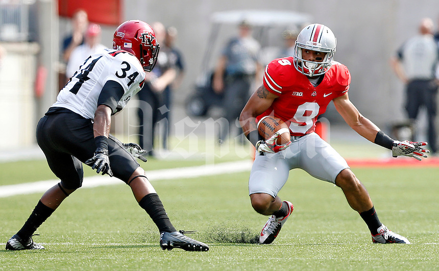 Ohio State Buckeyes wide receiver Devin Smith (9) heads up field after a catch against San Diego State Aztecs defensive back J.J. Whittaker (34) during the 1st quarter of their college football game at Ohio Stadium in Columbus on September 7, 2013.  (Dispatch photo by Kyle Robertson)