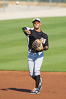 Hickory Crawdads shortstop Luis Marte (13) makes a throw to first base against the Kannapolis Intimidators at CMC-Northeast Stadium on April 9, 2014 in Kannapolis, North Carolina.  The Intimidators defeated the Crawdads 1-0.  (Brian Westerholt/Four Seam Images)