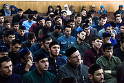 Students of the Islamic University in Grozny (men in the front, women in the back) listen to a lecture bya guest mullah from Jordan. Grozny, Chechnya, Russia, 2013