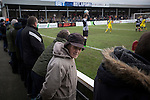 Home supporters watching the action during the first-half at Victory Park, as Chorley played Altrincham (in yellow) in a Vanarama National League North fixture. Chorley were founded in 1883 and moved into their present ground in 1920. The match was won by the home team by 2-0, watched by an above-average attendance of 1127.