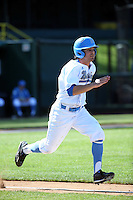 Daniel Amaral (25) of the UCLA Bruins runs to first base during a game against the Texas Longhorns at Jackie Robinson Stadium on March 12, 2016 in Los Angeles, California. UCLA defeated Texas, 5-4. (Larry Goren/Four Seam Images)