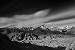 Sunrise on Lone Pine Peak in the High Sierra from Alabama Hills in this black and white landscape shot.