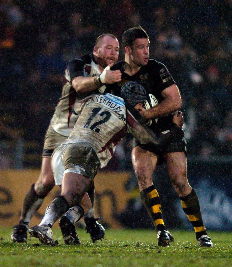 Photo: Jonathan Butler..London Wasps v Newcastle Falcons. Guinness Premiership. 08/01/2006..Wasps' Joe Worsley is tackled by Mark Mayerhofler and Robbie Morris.