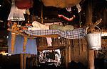 INDIA Mumbai, urban agriculture, stable with buffalos for milk production in living area in suburban Andheri, milk men live and sleep in stable / INDIEN Mumbai, urbane Landwirtschaft, im Stadteil Andheri befinden sich Bueffelstaelle in Wohngebieten, nach dem Melken wird die frische Milch direkt verkauft