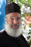 Greece, Aegean Islands, Southern Sporades, Island Samos, near Ireon: Greek Orthodox priest, owner of Pappa Beach | Griechenland, Aegaeis, Suedliche Sporaden, Insel Samos, bei Ireon: Griechisch-Orthodoxer Priester, Eigentuemer des Pappa Beach