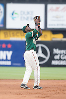 Greensboro Grasshoppers shortstop Javier Lopez (16) settles under a pop fly against the Hagerstown Suns at NewBridge Bank Park on May 20, 2014 in Greensboro, North Carolina.  The Grasshoppers defeated the Suns 5-4. (Brian Westerholt/Four Seam Images)