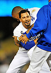 23 July 2011: Los Angeles Dodgers infielder Rafael Furcal is smothered by Matt Kemp after Furcal hit a game-winning, walk-off, RBI double in the bottom of the 9th inning against the Washington Nationals at Dodger Stadium in Los Angeles, California. The Dodgers rallied to defeat the Nationals 7-6. Mandatory Credit: Ed Wolfstein Photo