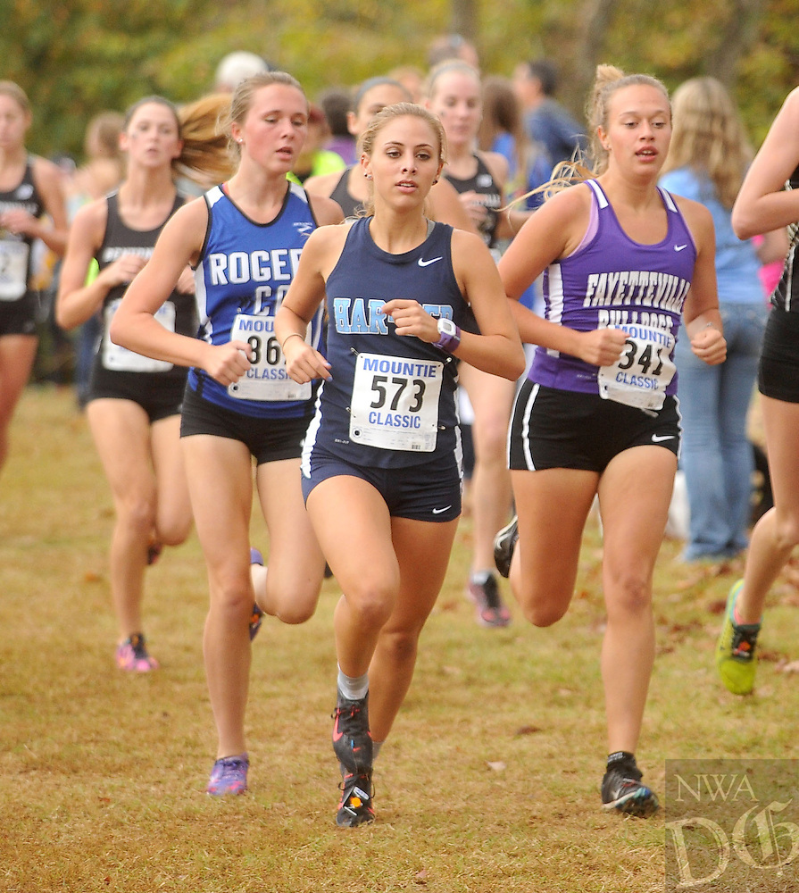 NWA Democrat-Gazette/MICHAEL WOODS &bull; @NWAMICHAELW<br /> Elise Reina, Har-Ber cross country runner (573), leads the pack on her way to take first place Tuesday October 27, 2015 at the Rogers Mountie Classic girls 7A West Conference Championship race in Rogers.
