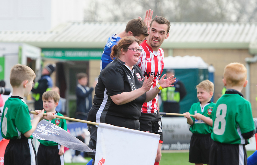 Lincoln City invited a group of mothers to be match day mascots the day before Mothering Sunday<br /> <br /> Photographer Chris Vaughan/CameraSport<br /> <br /> The EFL Sky Bet League Two - Lincoln City v Macclesfield Town - Saturday 30th March 2019 - Sincil Bank - Lincoln<br /> <br /> World Copyright © 2019 CameraSport. All rights reserved. 43 Linden Ave. Countesthorpe. Leicester. England. LE8 5PG - Tel: +44 (0) 116 277 4147 - admin@camerasport.com - www.camerasport.com