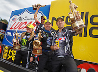 Mar 20, 2016; Gainesville, FL, USA; NHRA top fuel driver Brittany Force (left) celebrates with teammate and funny car winner Robert Hight , pro stock motorcycle rider Eddie Krawiec and pro stock driver Greg Anderson after winning the Gatornationals at Auto Plus Raceway at Gainesville. Mandatory Credit: Mark J. Rebilas-USA TODAY Sports