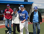 Western Nevada College's Rayne Raven escorts his family onto the field for Sophomore Day festivities at John L. Harvey field, on Sunday, April 27, 2014, in Carson City, Nev.<br /> Photo by Cathleen Allison/Nevada Photo Source
