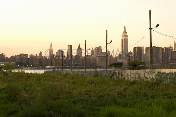 AVAILABLE FROM JEFF AS A FINE ART PRINT.<br /> <br /> AVAILABLE FROM PLAINPICTURE FOR COMMERCIAL AND EDITORIAL LICENSING. Please go to www.plainpicture.com and search for image # p5690109.<br /> <br /> Empire State Building and Manhattan Skyline at Dusk, viewed from the Williamsburg neighborhood of Brooklyn