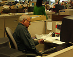 Arnie Abrams seen working in Cityroom at Newsday office in Melville on Friday March 25, 2005. (Photo copyright Jim Peppler 2005).