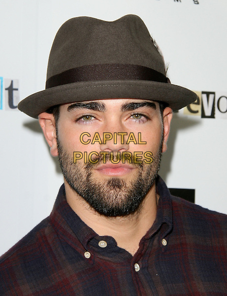 JESSE METCALFE.The Weinstein Company Film premiere of ''Youth In Revolt'' held at The Mann Chinese 6 Theatre in Hollywood, California, USA..January 6th, 2010.headshot portrait black grey gray brown hat fedora trilby beard facial hair .CAP/RKE/DVS.©DVS/RockinExposures/Capital Pictures.
