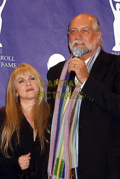 STEVIE NICKS & MICK FLEETWOOD - FLEETWOOD MAC.2005 Rock and Roll Hall of Fame Induction Ceremony held at the Waldorf Astoria, New York, New York.March 14th, 2005.Photo Credit: Laura Farr/AdMedia.half length  scarf beard facial hair glasses microphone.www.capitalpictures.com.sales@capitalpictures.com.© Capital Pictures.